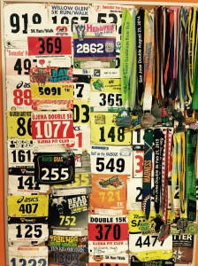 Race medals and bibs. The Hellyer bib is in the middle at the top, number 2862.