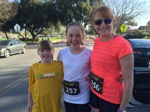 Rosie, Lucy, and Selina ready to race the Mardi Gras Madness 5k